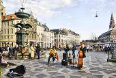 Denmark. Copenhagen. Musicians near Fountain Stork