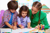 Teacher with children drawing