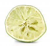 Squeezed lime isolated on white