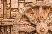 image of chariot  - A chariot wheel carved into the wall of the sun temple at Konark - JPG