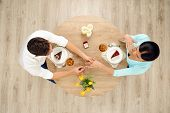 picture of marriage proposal  - Top view of round table with couple on date - JPG