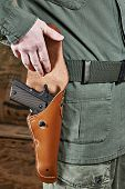Soldier Opens Pistol Holster