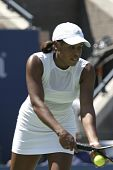 African American woman playing tennis