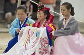 Women demonstrate traditional Korean wedding dress in Yongin, Korea.