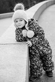 Adorable Little Girl For A Walk In A Winter