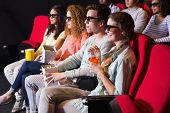 pic of watching movie  - Young friends watching a 3d film at the cinema - JPG