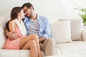 Young couple relaxing on couch at home in the living room