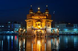 stock photo of harmandir sahib  - Golden Temple (Harmandir Sahib also Darbar Sahib) at night. Amritsar. Punjab. India