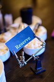 picture of freaky  - Reserved sign in freaky mechanism in the restaurant - JPG