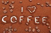 foto of coffee grounds  - Coffee word written on ground coffee and coffee grains - JPG