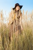 foto of tallgrass  - Young model in tallgrass meadow  - JPG