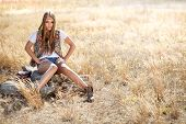 foto of tallgrass  - Hippie looking girl sitting on a tree stump - JPG