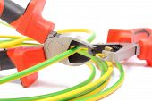 pic of pliers  - Metal pliers with tangled green - JPG