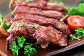stock photo of ribs  - Grilled pork ribs on plate shallow depth of field - JPG