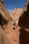 picture of cave woman  - Woman Hiker Backpacker hiking narrow slot canyon - JPG