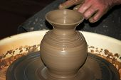 pic of molding clay  - the clay pot made hands of the person - JPG