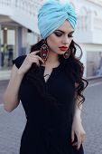 pic of turban  - fashion outdoor photo of beautiful sensual woman with long dark hair wearing elegant black dress and silk turban on head - JPG