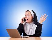stock photo of nun  - Nun working on laptop  - JPG