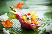 stock photo of dragon fruit  - Exotic fruit salad served in half a dragon fruit - JPG