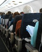 picture of flight attendant  - air passengers flying to a destination on an airplane.