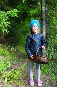 picture of gathering  - Little cute girl gathering mushrooms in an autumn forest - JPG