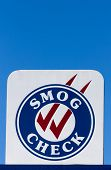 picture of smog  - Smog Check sign at automotive repair shop in the United States - JPG