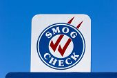 image of smog  - Smog Check sign at automotive repair shop in the United States - JPG