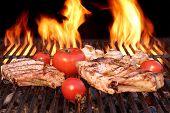 image of rib eye steak  - BBQ Pork Rib Pepper Steak Tomato And Mushrooms On The Hot Flaming Charcoal Grill - JPG
