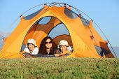 picture of family fun  - Happy family camping in the mountains - JPG