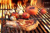 pic of rib eye steak  - BBQ Pork Rib Pepper Steak Tomato And Mushrooms On The Hot Flaming Charcoal Grill - JPG