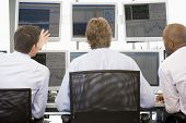 Stock Traders Viewing Monitors