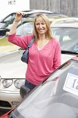 pic of car key  - Woman collecting new car - JPG