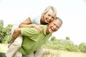 picture of woman couple  - Mature couple having fun in countryside - JPG