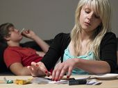 stock photo of drug addict  - Teenage Couple Taking Drugs At Home - JPG