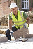 Construction Worker Laying Blockwork