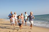 stock photo of beach holiday  - Portrait Of Three Generation Family On Beach Holiday - JPG