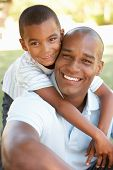 stock photo of father child  - Portrait of Happy Father and Son In Park - JPG