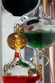 pic of galileo-thermometer  - close up of a glass Galileo thermometer