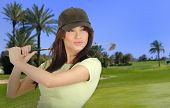 Driving golf player on green background
