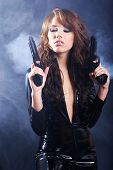 Sexy girl holding a black gun