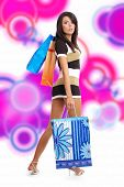 beautiful sexy shopping girl holding bag over abstract blur  design background