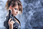 foto of raider  - beautiful sexy girl holding gun  - JPG
