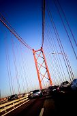 Cars Passing Through 25 De Abril Bridge In Lisbon (Portugal)