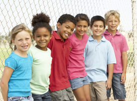 stock photo of children group  - Group Of Children Playing In Park - JPG