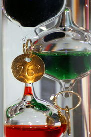 stock photo of galileo-thermometer  - close up of a glass Galileo thermometer