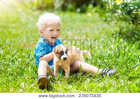 poster of Kids Play With Puppy. Children And Dog In Garden.