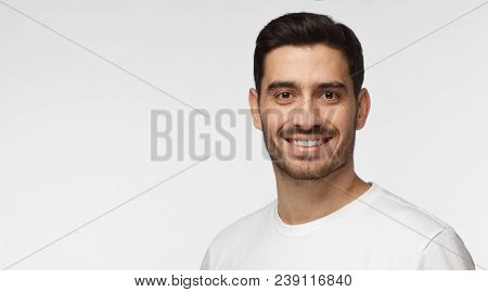 poster of Closeup Headshot Of Young European Caucasian Man Isolated On Gray Background Wearing Casual White T-