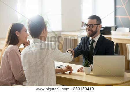 poster of Smiling Lawyer, Realtor Or Financial Advisor Handshaking Young Couple Thanking For Advice, Insurance