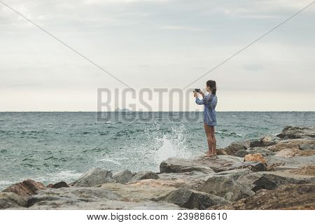 poster of Young Woman Taking Travel Photos. Woman Taking Travel Landscapes Near Sea. Young Girl Taking Photos