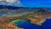 Aerial View Of Koko Head, Maunalua Bay Lagoon And Honolulu Coastline  In Hawaii From A Helicopter poster